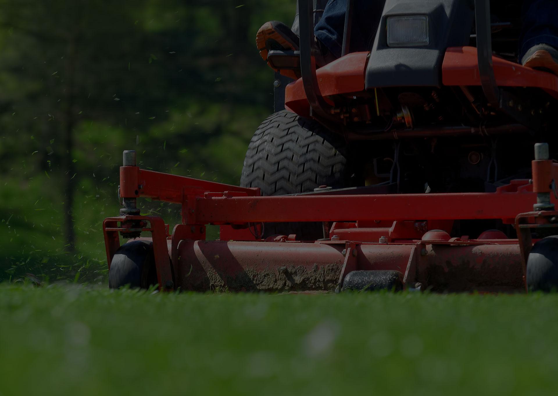man riding on lawn mower